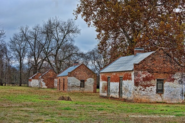 Row of brick slave/tenant cabins at Magnolia