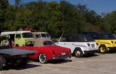 Parking lot at Oakland full of a variety of Volkswagen vehicles from the Volkswagen CENLA Club.