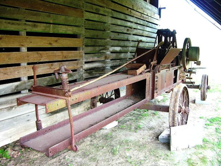Antique hay bailer at Magnolia plantation