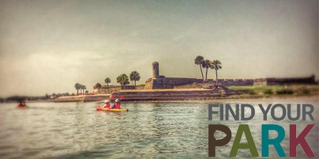 Kayakers paddling in front of the Castillo de San Marcos National Monument