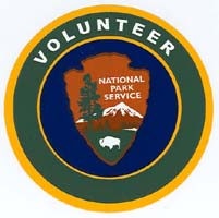 Volunteer logo, green border, dark blue background, and NPS arrowhead in center.