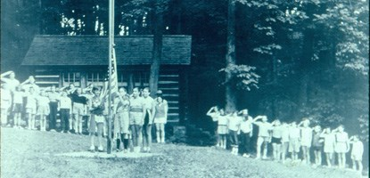 Girl Scouts raising the flag in 1950.