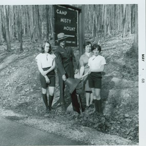 Superintendent Frank Mentzer with Girl Scouts at Camp Misty Mount in 1968.