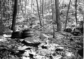 Old mash barrels are sometimes still discovered in the woods today.