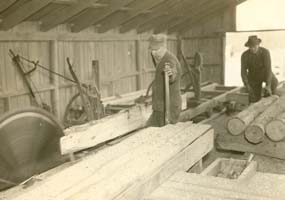 Cutting lumber at the WPA sawmill.
