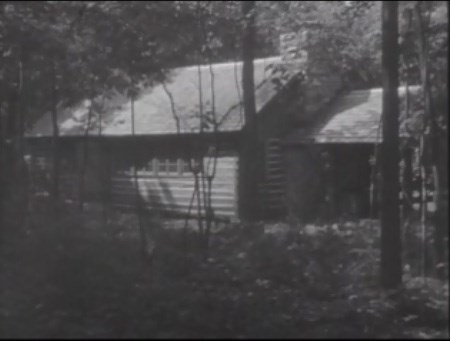 Housing at OSS Training Camp showing a log cabin.