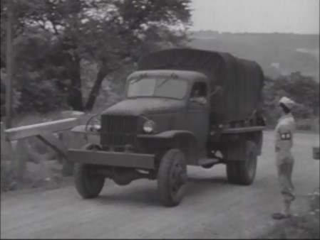 Transportation of OSS recruits to secret training camp in Catoctin in trucks under guard.