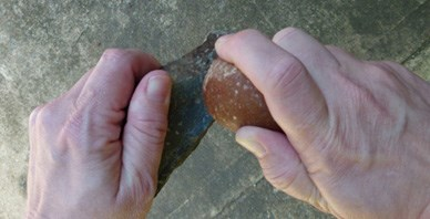 Native Americans probably used a stone hammer, similar to this, to knock flakes from the metarhyolite.