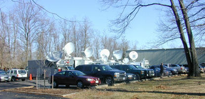 Sattelite trucks lined up for news coverage during the Tony Blair - President Bush press event.