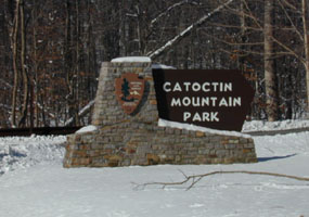 Catoctin Mountain Park entrance sign in snow.