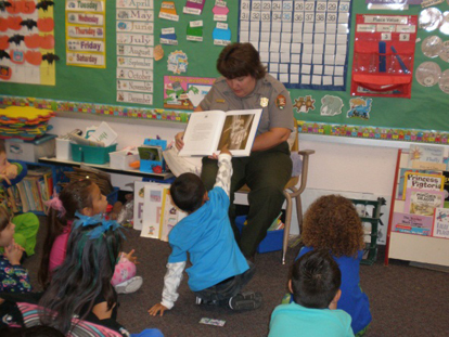 A ranger reads to a kindergarten class