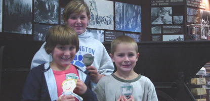 Three new Junior Rangers show off their patches to Flat Stanley.