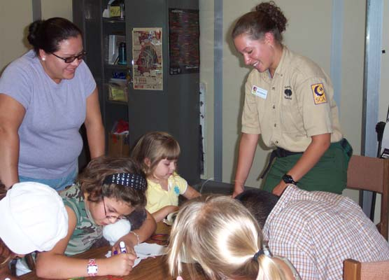 SCA Amy Johnson (left) helping out in the Kids Corner at Carlsbad Caverns National Park.