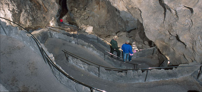 Visitors walking down the switchbacks on the Natural Entrance trail