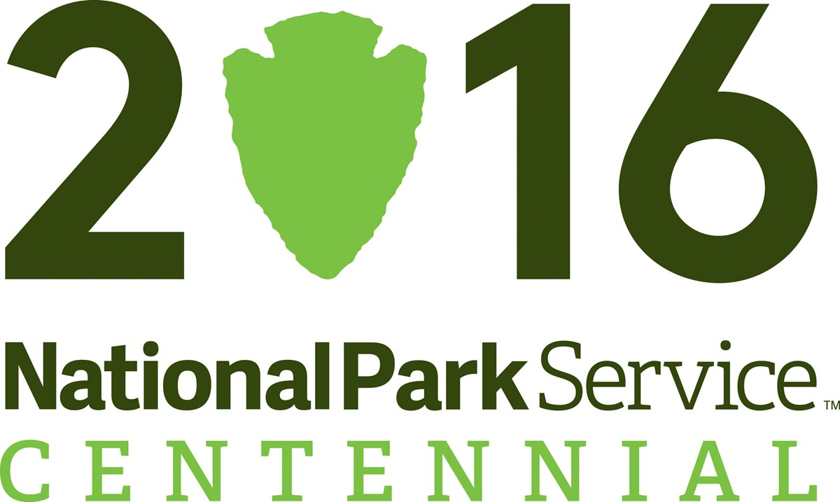 Logo Celebrating the 100 year anniversary of the National Park Service.  Logo reads 2016 National Park Service Centennial.  The zero in 2016 is the shape of the NPS arrowhead.