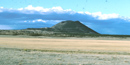 Color photograph showing Capulin Volcano in the distance
