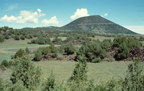 color photograph of Capulin Volcano at greenup in the spring.