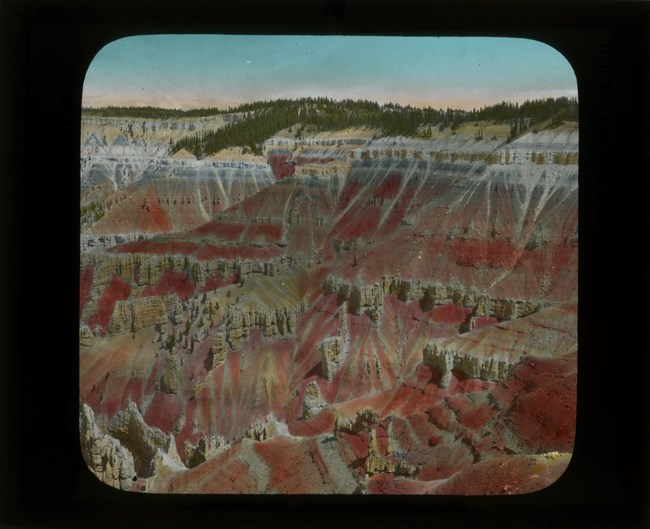 Old slide image of pink and orange cliffs of Cedar Breaks National Monument.