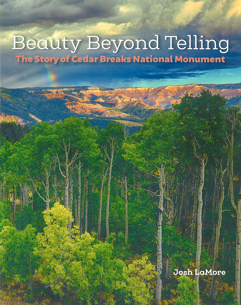 Book cover with landscape image of orange cliff and a rainbow overhead, with aspen trees below.