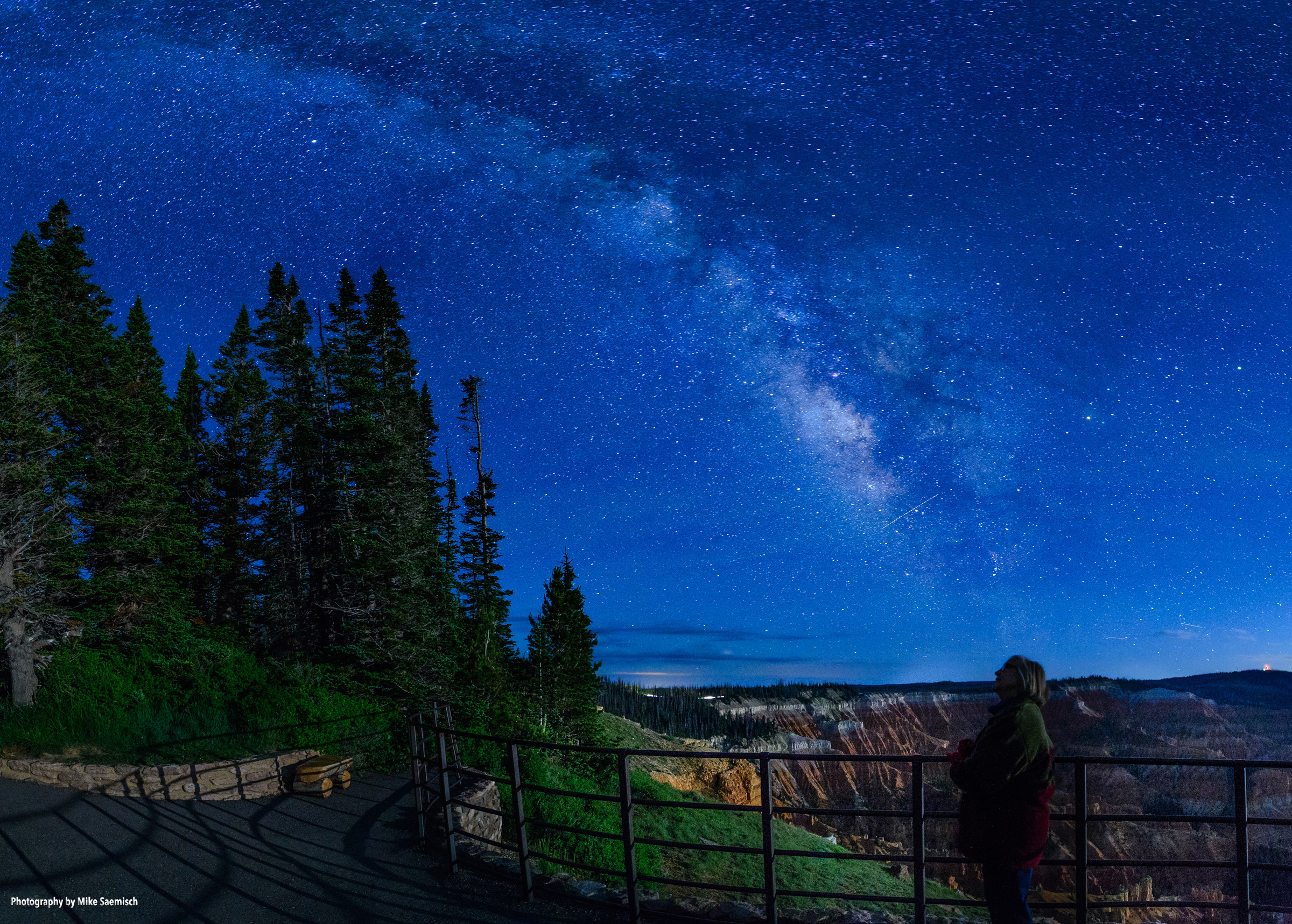 Visitors enjoy views of glittering stars above the Cedar Breaks Ampitheater