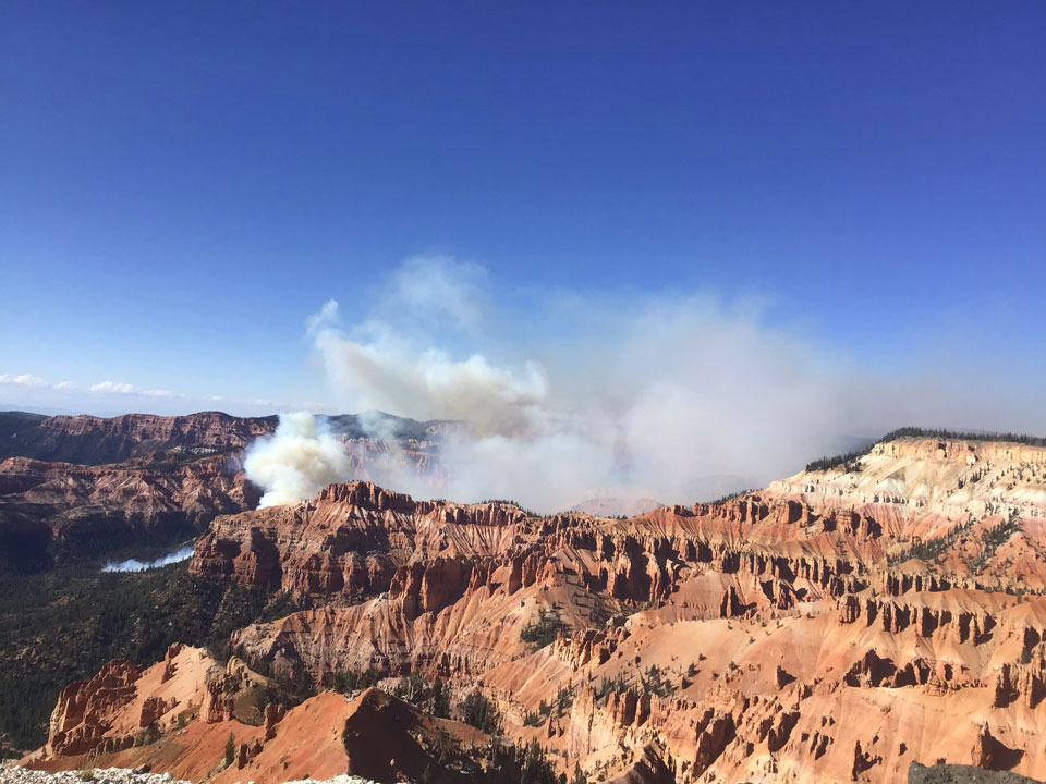 Chessman Fire Sept 19 - Smoke with forest and orange cliffs.