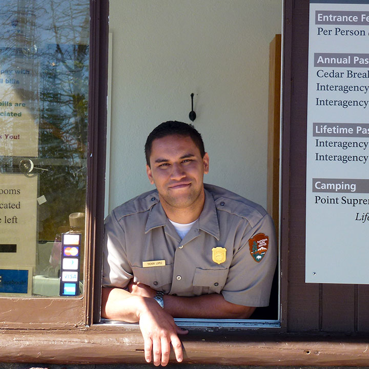 Park employee at fee booth