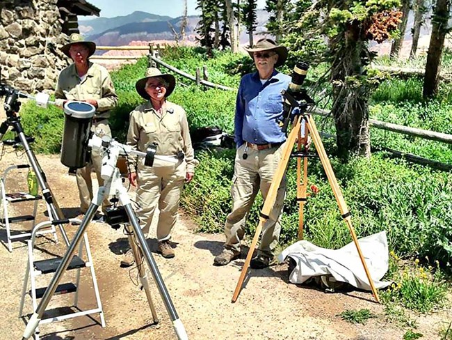Group of people with telescopes Solar Scope Viewing.