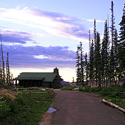 Information Center at sunset with a pathway and puddles in the foreground.