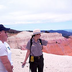 Ranger with two visitors on the rim of Cedar Breaks.