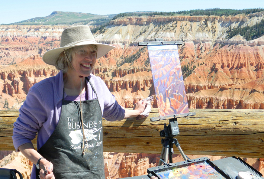 Artist standing with artwork on the rim of Point Supreme.