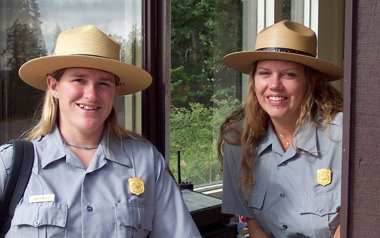 Two park rangers at a fee station