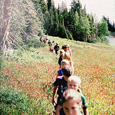 Kids hiking in a meadow