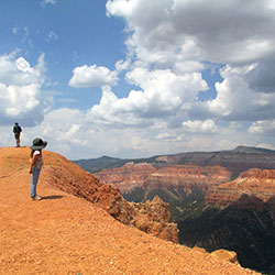 Child and man hiking on the rim of Cedar Breaks.