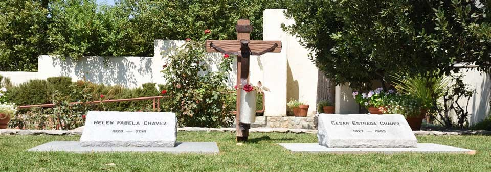 The graves of Cesar and Helen Chavez surrounded by green grass