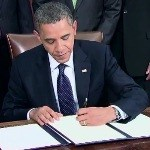 President Obama signs the Presidential Proclamation.