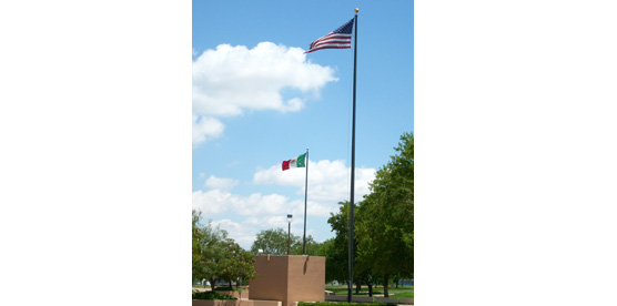 The flags of the United States and Mexico fly high at Chamizal National Memorial. The two nations came together in 1964 and peacefully settled their century-long border dispute.