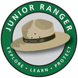 "Junior ranger logo - the words ""Junior Ranger: explore, learn, protect"" in a circle around a ranger hat"