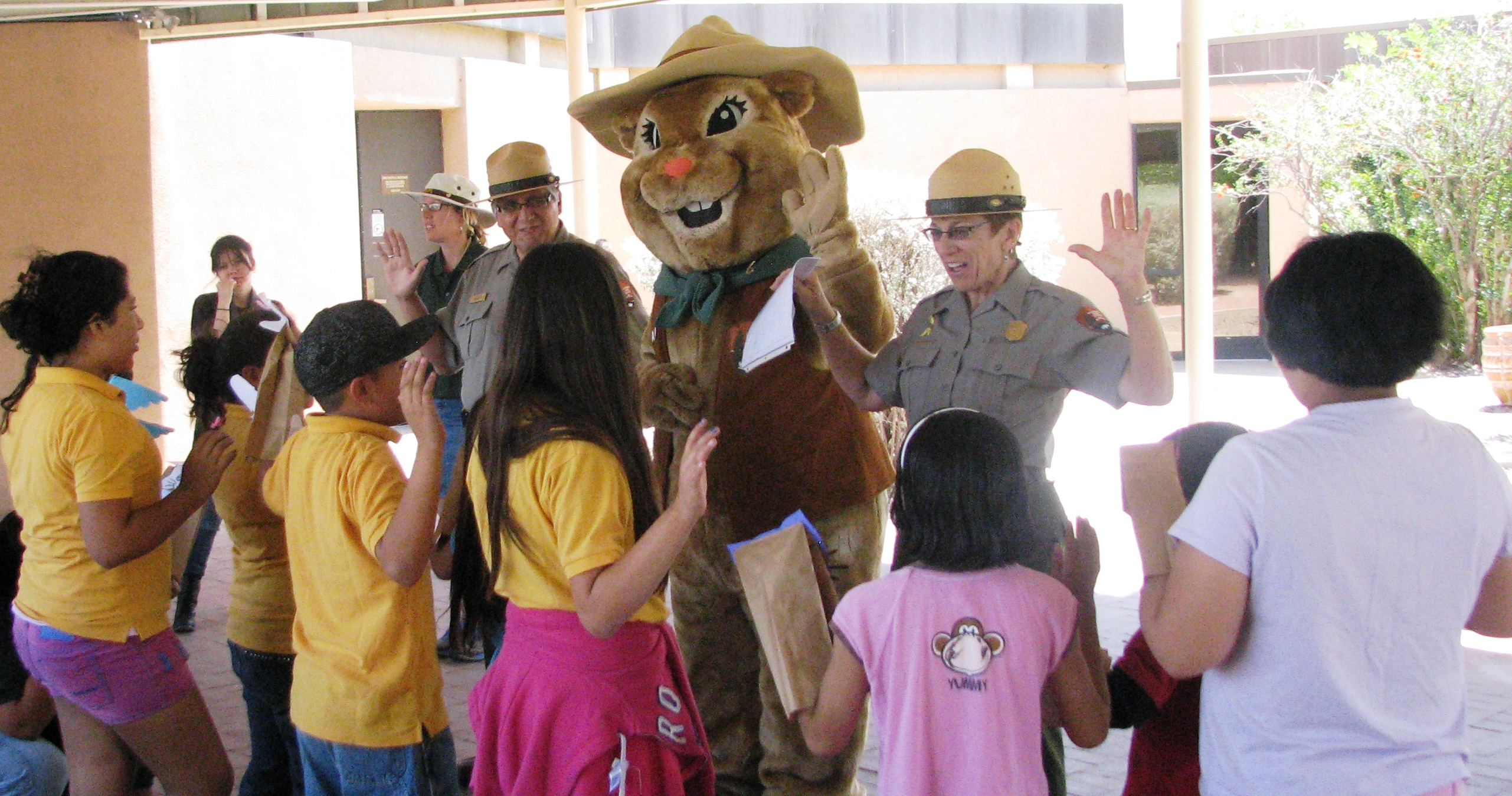young people raising right hand to take Junior Ranger oath