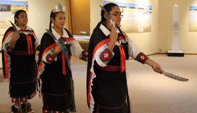 Native American women dancing in traditional dress