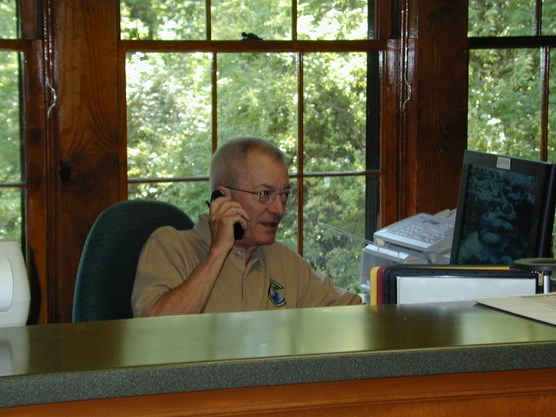 Volunteer Jack Switzer at the Visitor Center Front Desk