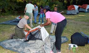 Park ranger Nancy Walther shows first time campers how to set up a tent.