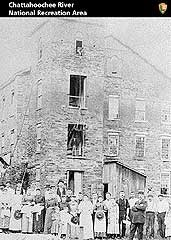 Black and white photograph of female workers outside the Ivy Mill.
