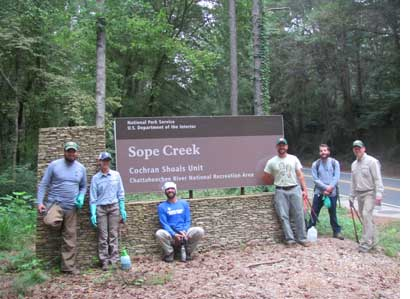 Crew in front of Sope Creek entrance sign
