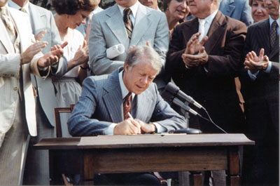 President Carter signing Act creating CRNRA