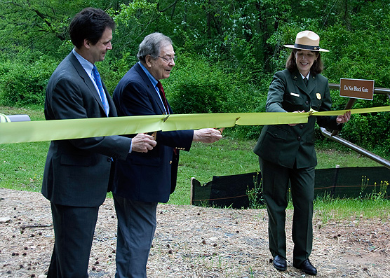 Ribbon-cutting at Earth Day dedication ceremony.  From left: Kevin Levitas, Former Congressman Elliott Levitas, Superintendent Patty Wissinger.