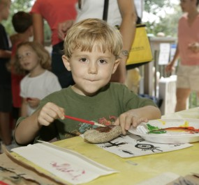 Child painting rock at the Chattahoochee River NRA Summer Festival.