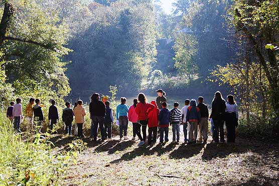 Students from Hamilto Homes ES learn about the Chattahoochee River from Ranger Marjorie Thomas while on a Ticket-to-Ride field trip.