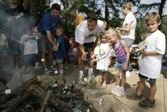 Kids Roasting Marshmallows at the Chattahoochee River Summer Festival.