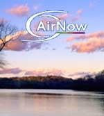 AirNow Logo superimposed over a photograph of scattered pinkish clouds drifting over the river in the evening.