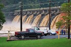 A view of flood waters flowing over the spillways at Morgan Falls Dam. Gates for all spillways are open.